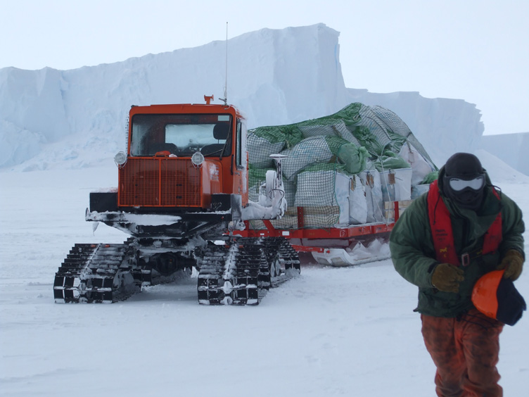 Jim and his Sno-Cat, loaded with waste