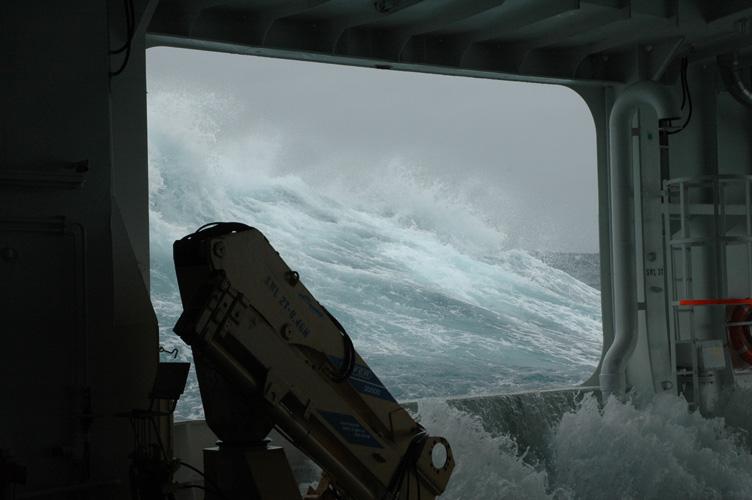 Waves break over the poop deck