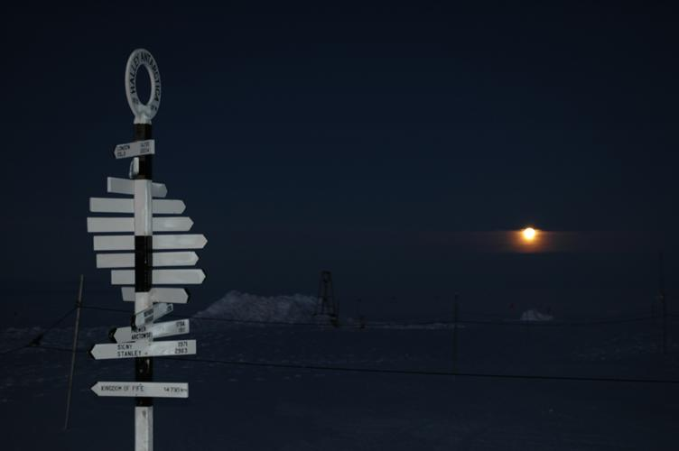 Signpost with moon behind (1 sec w/flash)