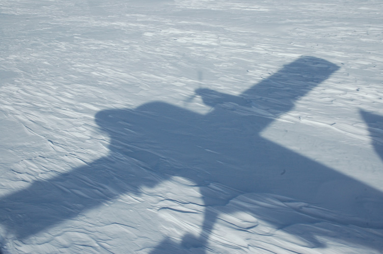 Twin Otter's shadow as we touch down skis at A84