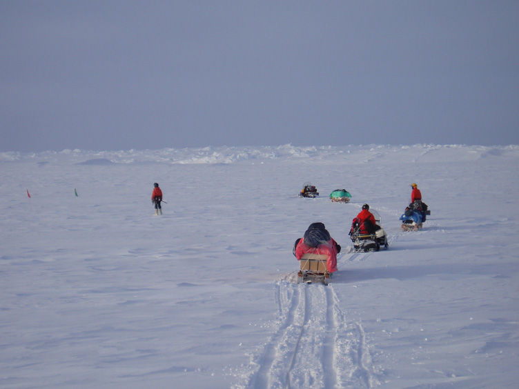 Linked skidoos arriving at the campsite