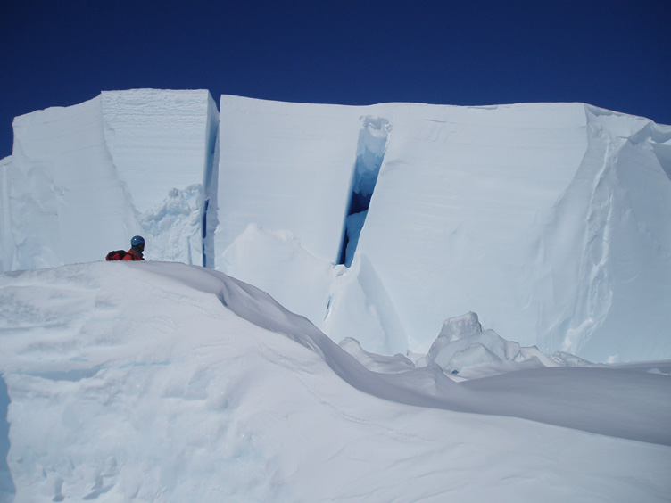 Simon inspects a crevasse revealed in a cliff