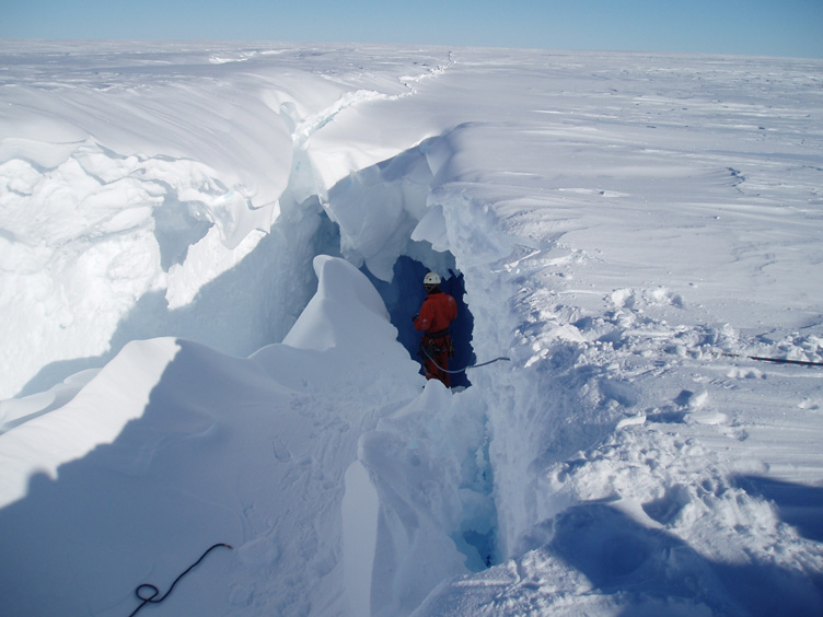 Andy peers into a bridged crevasse