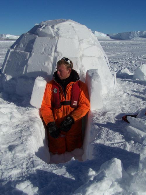 Tom leaves the finished igloo